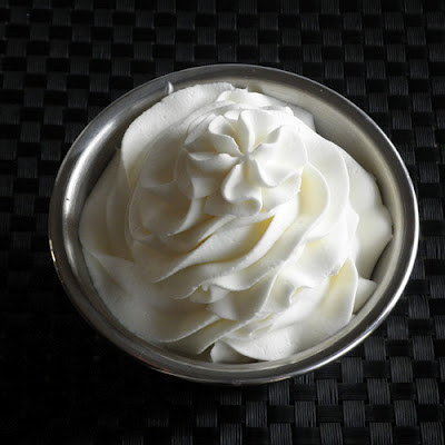 stabilized whipped cream on black close 500px